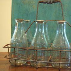 Vintage milk bottles in a carrier