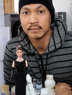 Noel Cruz, a professional doll repainter