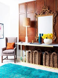 20 Must-Know Terms for Buying the Perfect Mirror | DomaineHome.com // Rococo mirror over console table in entryway.