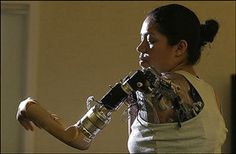 """This week, the Rehabilitation Institute of Chicago introduced the first woman to be fitted with its """"bionic arm"""" technology. Claudia Mitchell, who had her left arm amputated at the shoulder after a motorcycle accident, can now grab a drawer pull with her prosthetic hand by thinking, """"grab drawer pull."""""""