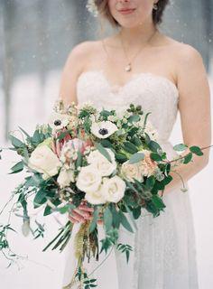 Winter wedding bouquet: http://www.stylemepretty.com/2014/04/24/enchanted-winter-wedding-inspiration/   Photography: Laura Leslie - http://www.lauralesliephotography.com/