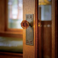 The renovation didn't skimp on small details like true-to-period crystal doorknobs and hammered backplates.