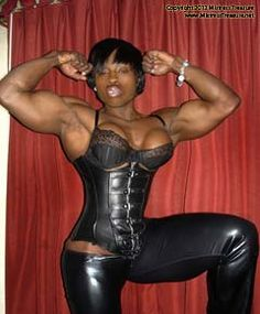 Muscular Ebony Domme in Black Leather