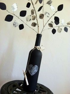 Up-Cycled Chalkboard Wine Bottle - Eco-Friendly Centerpiece - Wedding - Paper Leaves - Custom. $10.00, via Etsy.