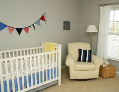 The flags and striped pillow are simple and perfect for this natural room. Less is more! Submitted by Allison F.