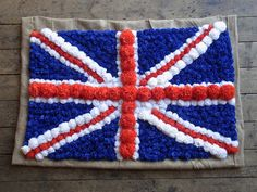 POM POM SAVE THE QUEEN - Pom Pom Factory: tissue pom Union Jack flag wall hanging...seriously?!!  Too cool.