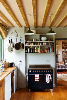 rustic kitchen, open shelving, exposed beams
