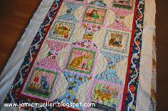 cat quilt RJR fabircs machine quilted with feathers