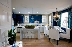 Classy blue and white kitchen and dining space - Decoist