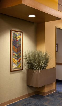 Incorporating art in healthcare design adds visual interest, aids in wayfinding, and acts as a positive distraction. Photo credit: Steve Henke.