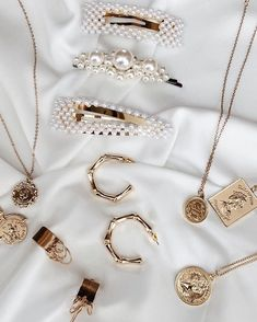 gold jewelry inspo | earrings, necklaces, and barette hair clips