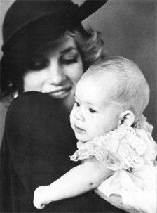 Prince Henry (known later as Harry) with his Mother, Princess Diana on his christening day, December 21, 1984