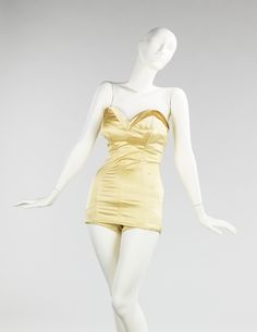 This incredibly glamorous gold bathing suit by Carolyn Schnurer dates from 1949 or 1950.