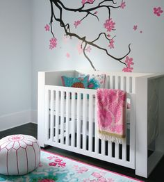 I am obsessed with tree wall art in babies' rooms.