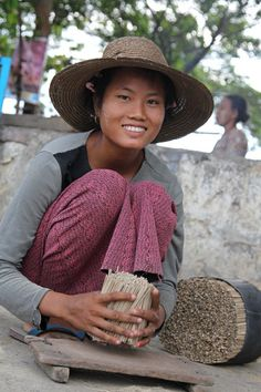 Street life in Mandalay, Myanmar--Photo by Bertrand Linet. (This lovely street vendor undoubtedly has no idea her image is traveling around the world.)