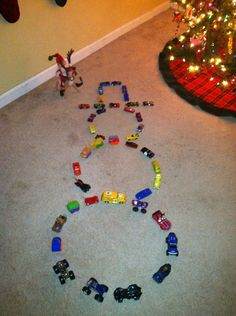 Elf makes a snowman out of cars.