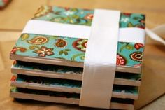 How to make your own coasters out of fabric or paper. SO easy and cheap! Tiles cost .19 cents!!!!!!