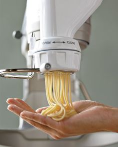 Kitchen Aid Pasta Press Attachment: Makes 6 styles of fancy pastas. Quite a pricey investment.