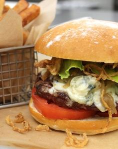 Culina's JC Burger is quickly becoming famous among Los Angelenos. It's comprised of ground short rib crowned with Maytag blue cheese, both caramelized and crispy onions, house special sauce and tomato, all served between two slices of house-made rosemary ciabatta. Click through for the recipe.