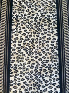 This Is a wool animal print carpet remnant that can be installed as a stair runner. This is one of thirty six new remnants that we have received in our latest package as of 9/25/2013. Be sure to come in soon, these designer rugs are a must see! carpetworkroom.com