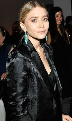 Ashley Olsen with turquoise drop earrings, a low ponytail & silk blazer #style #fashion #beauty #hair #mka #olsentwins