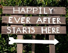 Happily ever after starts here. Sign made from planks of wood (looks like it could be from a weathered pallet?)