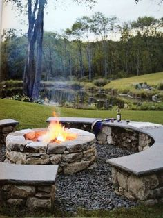 fire pit with stone bench surround and pond.