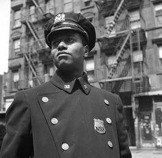 African American police officer in Harlem, New York, circa 1943. Photographer Gordon Parks for the Office of War Information (OWI).  http://blackhistoryalbum.com