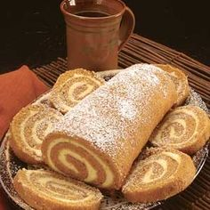 I make these every Fall!! Pumpkin Rolls 3 Eggs 1 C. Sugar 2/3 C. Pumpkin (1 Large can of Pumpkin yields 5 pumpkin rolls) 1 tsp. Lemon Juice ¾ C. Flour 1 tsp. Baking Powder 1 tsp. Salt 1 tsp. Nutmeg 2 tsp. Cinnamon 1/8 tsp. Ground Cloves ¼ tsp. Allspice Preheat oven to 325º. Put waxed paper on cookie sheet. Butter/spray lightly. (I measure out all of the dry ingredients-except for the sugar- in one bowl to dump in all at once while mixing-makes things go...