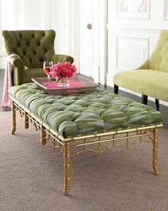 Chinoiserie faux bamboo ottoman painted gold with green pattern tufted upholstery.