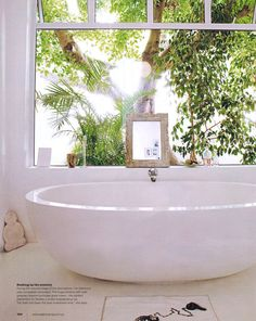 Beautiful bathroom tub with a view. I die.