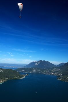 France is not just for lovers. Adventurers can parasail in beautiful locations such as Annecy, #France. #iGottaTravel