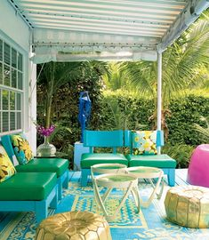 Even with all of the bright colors of this patio, the throw pillows really pull the look together! I also adore the beautiful turquoise rug! Photo from furniturestoreblog.com.  #grandinroad #HueDesignChallenge