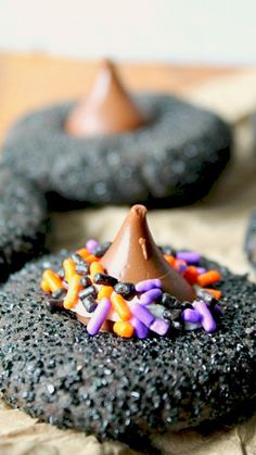 Witch Hat Peanut Butter Cookies Recipe ~ These make a perfect quick cookie for any Halloween party and the best part kids can help!  They can roll the cookie balls, coat them in the sugar, pop the kiss on and decorate with sprinkles!