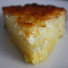 Impossible Coconut Pie: 4 tablespoons (1/2 stick) unsalted butter, melted  3/4 cups sugar  2 eggs 1/4 cup self-rising flour  1 1/4 cups sweetened shredded coconut 1 cup milk  1 teaspoon vanilla extract