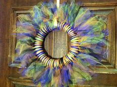 Super easy wreath. One 10 inch wreath. One yard each of black, lime, orange, and purple tule. Cut tule in half and then in 1/2 inch strips. Tie on.