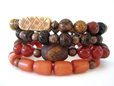Beaded stretch bracelets featuring Tibetan agate oval beads, 8mm carnelian beads, 8mm palm jasper beads, 8mm burnt horn carved beads, amber Buri tube beads, hand carved bone focal bead and antiqued copper beads. An eclectic mix of beads with vibrant colors and textures creating a bracelet stack that is sure to draw rave reviews. Wear stacked as shown or individually for a more simple statement. A versatile bracelet set that blends well with most any outfit. A must have for any fashionista!!!