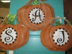 Monogrammed Pumpkin door hanger. $32.00, via Etsy.