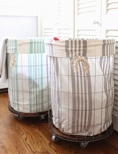 DIY laundry hamper: wire & a wood round on wheels.