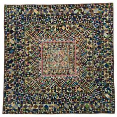 Bertha Neiden of Lincoln, NE, made this 10,222-piece quilt between 1909 and 1914. Bertha was a seamstress , and the quilt's wool fabrics may have been scraps from the custom clothing she sewed. It also may have been from cloth she brought with her when she immigrated to the United States from Russia. The quilt won a purple ribbon at the Nebraska State Fair in 1914.