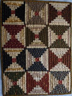 Courthouse steps doll quilt