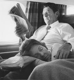 First Lady Nancy Reagan naps on her hubby's lap during a flight. Credit: UPI.
