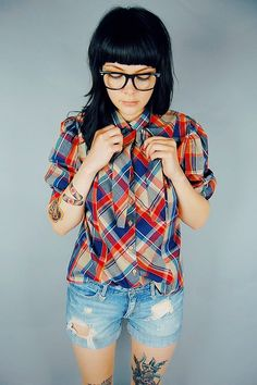 I like this outfit & all (mainly the shirt) but why does this girl have red eyebrows & black hair? I'm confused?