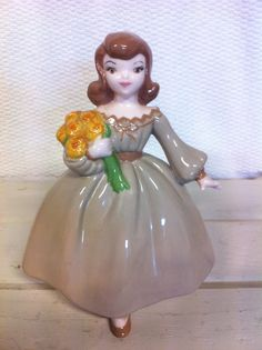 Vintage Lady with Flower Figurine