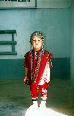A young child in traditional dress in Turkmenistan | Photo: Peace Corps #flickr | License: http://www.usa.gov/copyright.shtml