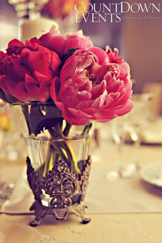 Pink peonies in rustic vintage goblet