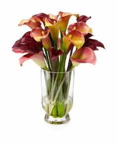 THIS should be on Anderson Cooper's RIDICULIST!!! A FAUX Cala Lily Arrangement.... ON SALE FOR $500.50!! They WERE ONE THOUSAND TWO HUNDRED AND TWELVE DOLLARS..... So........ pick up fresh Lily's at the store for say $15.00-$20.00 a bunch every week for a couple months AND have enough left over to make a donation to a Homeless Shelter or  BUY THESE! UNREAL