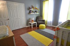 Love the yellow pouf and rug in this nursery. #yellow #nursery