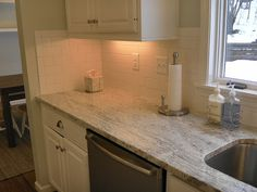Almost exactly what our kitchen is going to look like!  Our granite, dishwasher, cabinets, and sink!