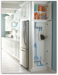 cleaning supplies storage closet - such a great use of space